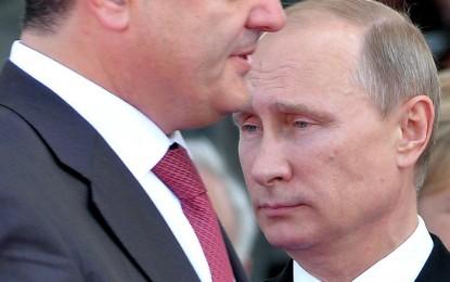 Путин и Порошенко обсъдиха примирието в Донбас