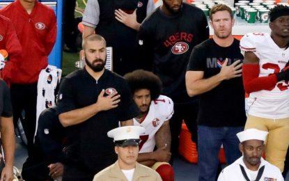 Обама защити американски футболист, който не се изправя за химна